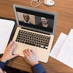 an open laptop with two people on a video call