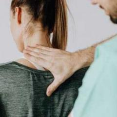 his is an image of a doctor pressing his hand on the back of a woman's neck