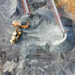 This is an image of an excavator working in what appears to be a coal mine