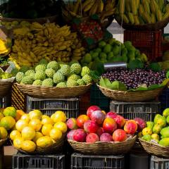 fresh fruit in baskets at a market