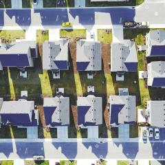 Ariel view of rows of identical houses in the suburbs.